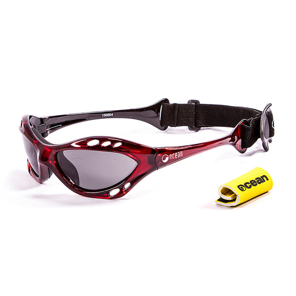 Ocean sunglasses model cumbuco 15000.4 with red frame and smoke lens polarized eyewear for water sports