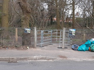 Kissing gate doing a great job of preventing access to a path by disabled people but a rubbish job at stopping fly tipping