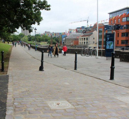 Setts sawn in half and re-laid to create a smoother surface for cycling