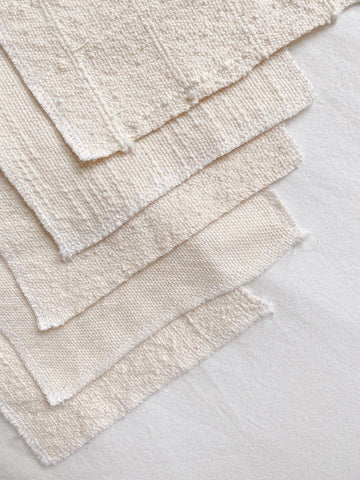 five organic cotton fabric samples featuring texture