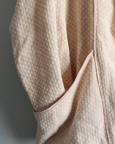 Close up of front seam and pocket showing piping details.