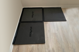 Drop-n-flop floor protector can be reconfigured to fit in corners.