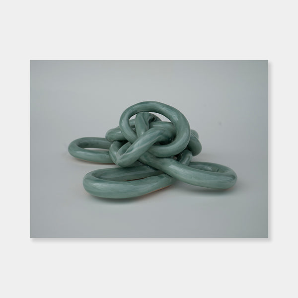 "Artsuite - Sangsun Bae - Gordian Knot 1 - Sculpture - Ceramic -9"" x 9"" x 4""- Bae expresses herself through soft and graceful lines and interlocking curves. By using organic forms, her work has a flowing elegance demonstrating complete abstraction. This basic element in her work reflects the stoic style of expression that invokes ties to Buddhism."