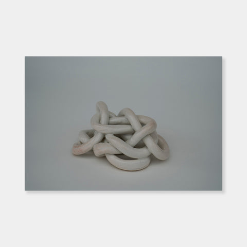 "Artsuite - Sangsun Bae - Gordian Knot 3 - Sculpture - Ceramic - 8"" x 7"" x 4""- Bae expresses herself through soft and graceful lines and interlocking curves.  By using organic forms, her work has a flowing elegance demonstrating complete abstraction.  This basic element in her work reflects the stoic style of expression that invokes ties to Buddhism."
