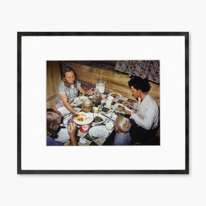 Artsuite - Debbie Grossman - The Fae and Doris Caudill family eating dinner in their dugout - originally photographed by Russell Lee for the United States Farm Security Administration in 1940. Using Photoshop to manipulate the original images, Grossman has created an imaginary, parallel world— a town populated exclusively by women.