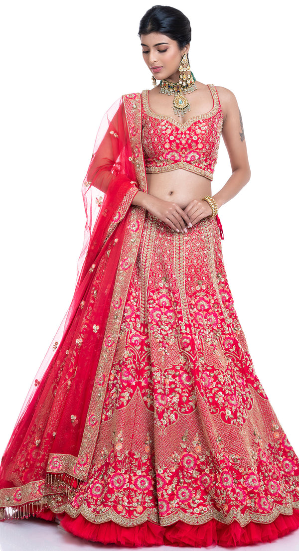 bridal lehenga trends 2021 Beautiful Lehenga in Coral colour in pure raw silk and embellished with all very intricate hand embroidery of sequin, naqshi and zardozi embroidery and with an elaborate ghera of four and a half meters.  Matched with a designer sleeveless choli, the lehenga looks very modern and joyfully traditional at the same time.