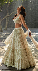 Multi tier lehenga on a georgette fabric and done up with tiny sequin sitara embroidery and teamed up with a very stylish choli and a georgette dupatta.