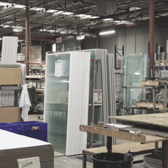 Clearlite factory showing shower doors ready for packing
