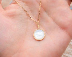 pearlised reverse side of gold pendant