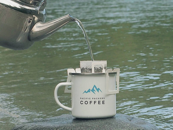 Pouring hot water over the coffee grounds. Pacific Packers Coffee is best when hiking or camping in Canada!