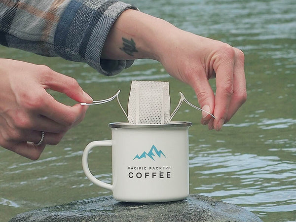 Placing outdoor coffee on the Canadian enamel camping mug