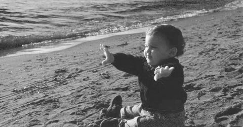 baby Cipriano on the beach