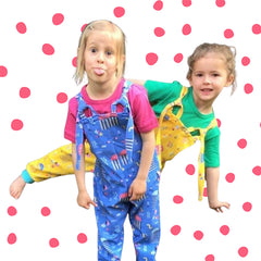Two girls posing playfully in exclusive Rockit Handmade dungarees only available at Little Bit Margate