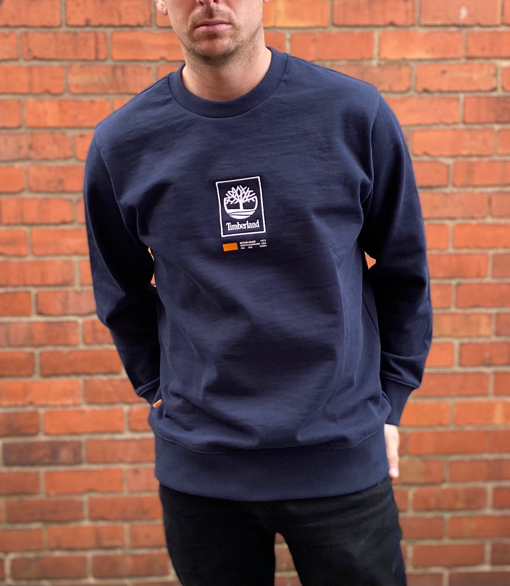 Navy, thick, round-neck Timberland jumper, with small, embroidered Timberland logo in white on the centre chest