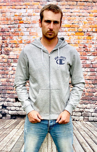 "Grey zip-up hoody with white drawstrings, front pockets and ""Ath. Dept."" printed in navy above a large ""C"" of the same colour"