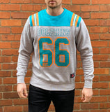Miami Dolphins NFL fleece jumper in grey and teal, with orange and white trims, large print Miami Dolphins logo and 66 on the centre chest
