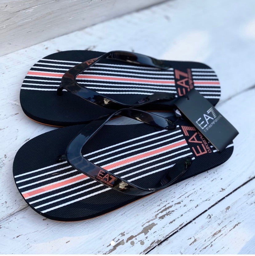 Pair of black Emporio Armani 7 flip flops with white stripes and red printed logo on the sole and straps