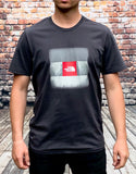 Grey The North Face round-neck tee shirt / Tshirt. Small, red, box logo in a silver square on the chest and small, white, printed logo on the reverse shoulder