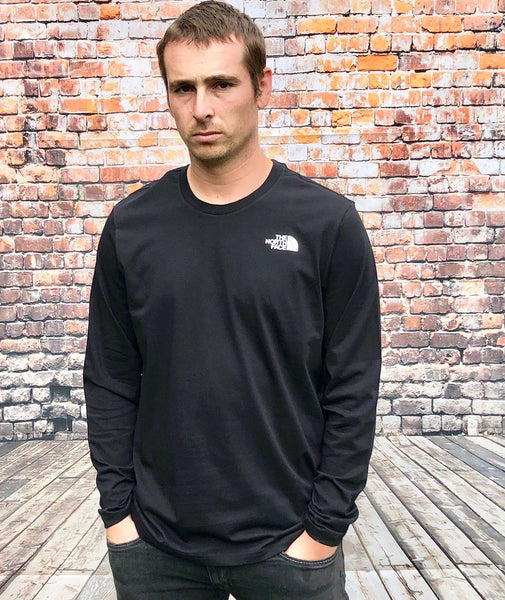 Black The North Face round-neck, long-sleeved tee shirt / Tshirt, with small, white printed logo on the left of the chest and a large, white printed logo on the centre back