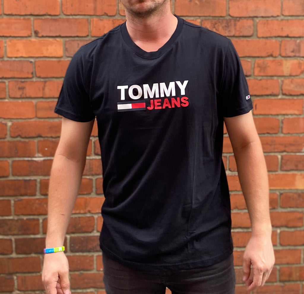 Black Tommy Hilfiger Jeans round-neck tee shirt / Tshirt, with large Tommy Jeans logo on the chest and small Tommy logo on the sleeve
