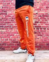Orange Champion sports joggers, jogging bottoms with white logo, cuffed ankles and drawstring