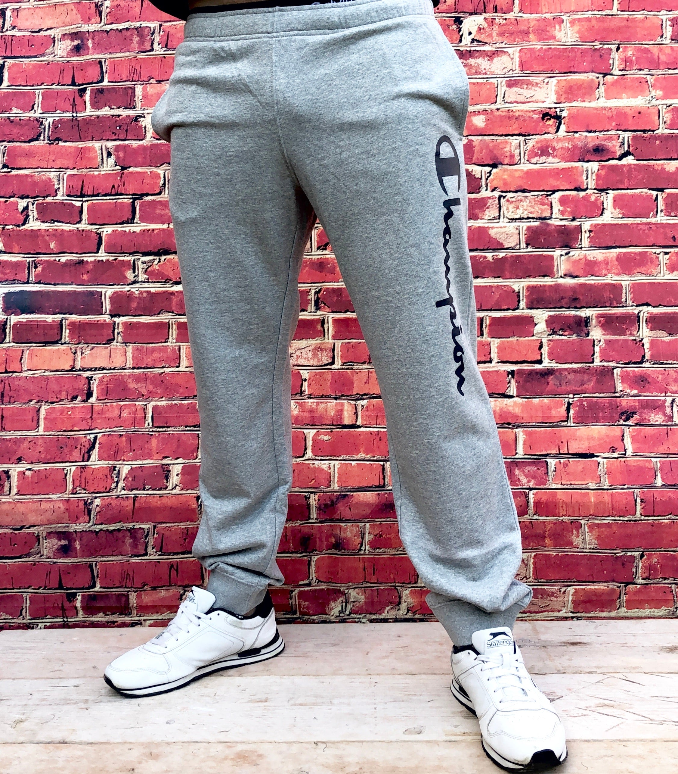 Grey Champion sports joggers, jogging bottoms with white logo, cuffed ankles and drawstring