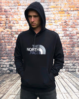 Thick, black, The North Face hoody, with large, embroidered, North Face logo on the chest in silver and white and black drawstrings