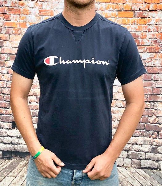 Navy, round-neck Champion tee shirt with large printed logo on the chest