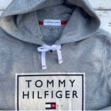 Grey, thin, Tommy Hilfiger summer hoody, with large white square on chest with printed Tommy Hilfiger logo and lettering in navy, white drawstring and pockets