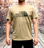 Beige The North Face round-neck, short-sleeved tee shirt / Tshirt, with large, grey printed logo on the chest and a small, grey printed logo on the back shoulder