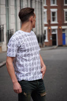 White Alexander McQueen round-neck tee shirt / Tshirt, with black, printed, skull logo all over, and a white neck trim