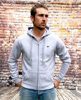Grey, thick Lacoste hoody, hooded jumper with hood. Features Lacoste crocodile logo on the left chest and grey drawstrings