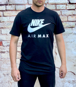 Black, round-neck Nike Air sports tee shirt, with large, white, printed logo and swoosh across the chest
