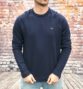 Navy, thin Lacoste long-sleeved tee shirt, with Lacoste crocodile logo on the left of the chest