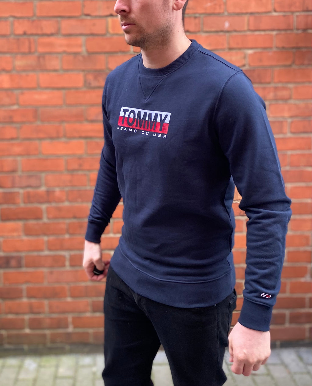 Navy Tommy Hilfiger Spellout jumper / sweater with Tommy Jeans Co USA embroidered across the chest and Tommy logo on the end of the sleeve