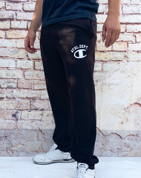 "Black Champion sports joggers, jogging bottoms with white, printed logo on the thigh with ""Athl. Dept."" lettering, cuffed ankles and drawstring"