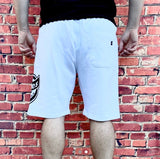 White Dickies shorts, with large, printed Dickies logo across the left thigh in black, and black Dickies tab on the reverse pocket. Comes with side pockets and drawstring