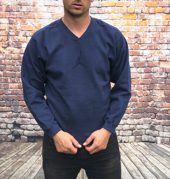 Navy, thick, V-neck Nike jumper, with large, printed Nike basketball logo on the chest and trims down the back