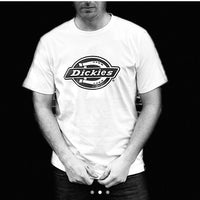 Round-neck, white Dickies Tshirt, with large, printed Dickies logo across the chest in black, and black Dickies tab on the seam