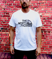 White The North Face round-neck tee shirt / Tshirt, with large, faded-style, black, printed logo across the chest and small, black, printed logo on the reverse shoulder