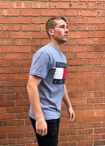 Blue Tommy Hilfiger Jeans round-neck tee shirt / Tshirt, with large, printed Tommy Jeans logo on the chest and small, embroidered logo on the sleeve