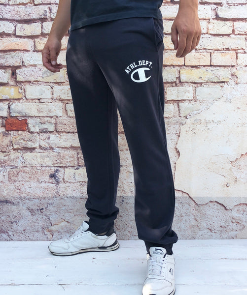 "Navy Champion sports joggers, jogging bottoms with white ""C"" logo on the thigh, cuffed ankles and drawstring"