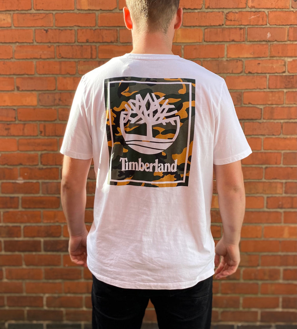 White Timberland round-neck tee shirt / Tshirt, with small, printed Timberland logo on the left of the chest, and large printed camo logo on the rear