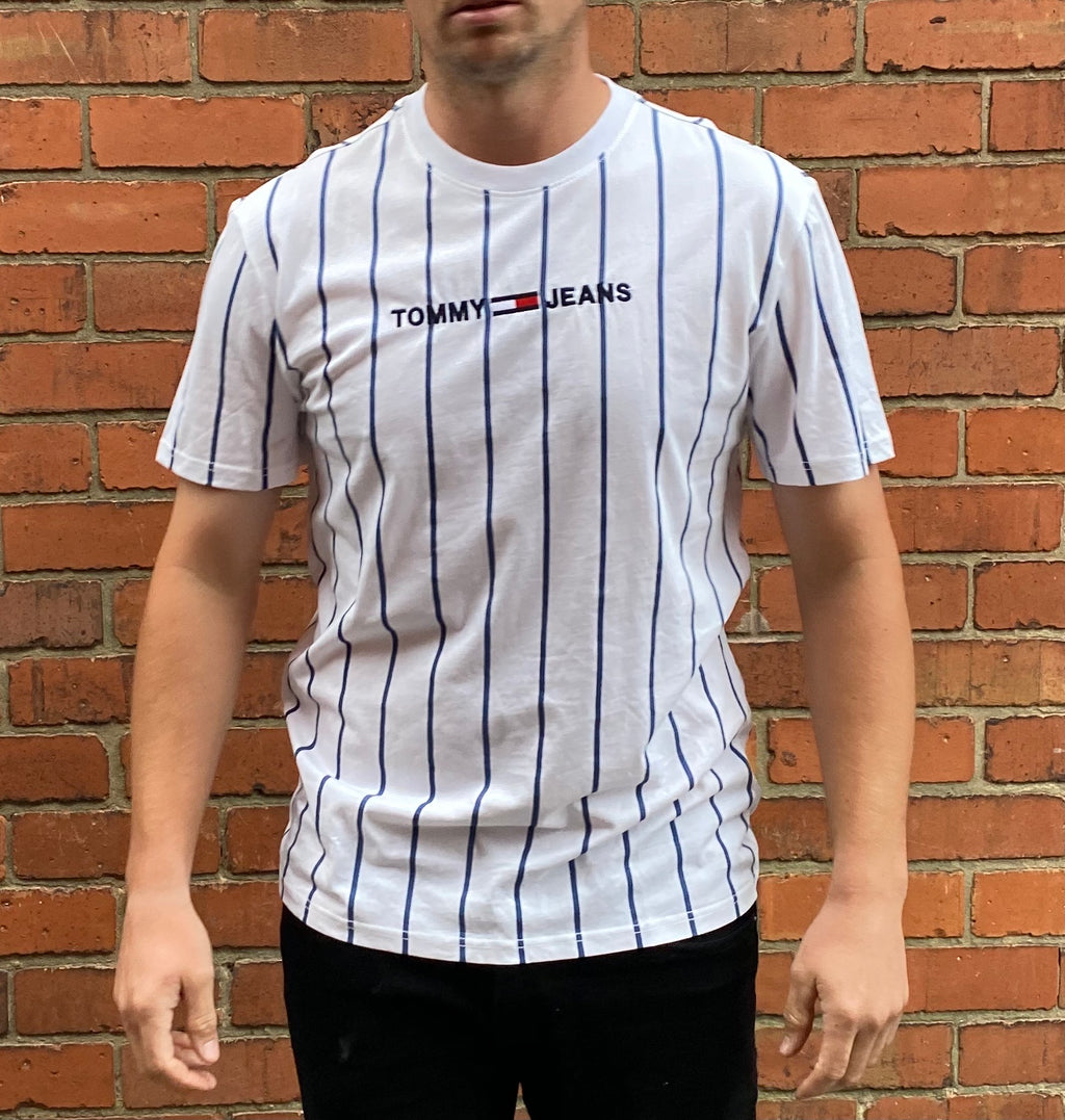 White, Tommy Hilfiger, short-sleeved tee shirt, with blue vertical stripes and an embroidered Tommy Jeans logo on the centre chest