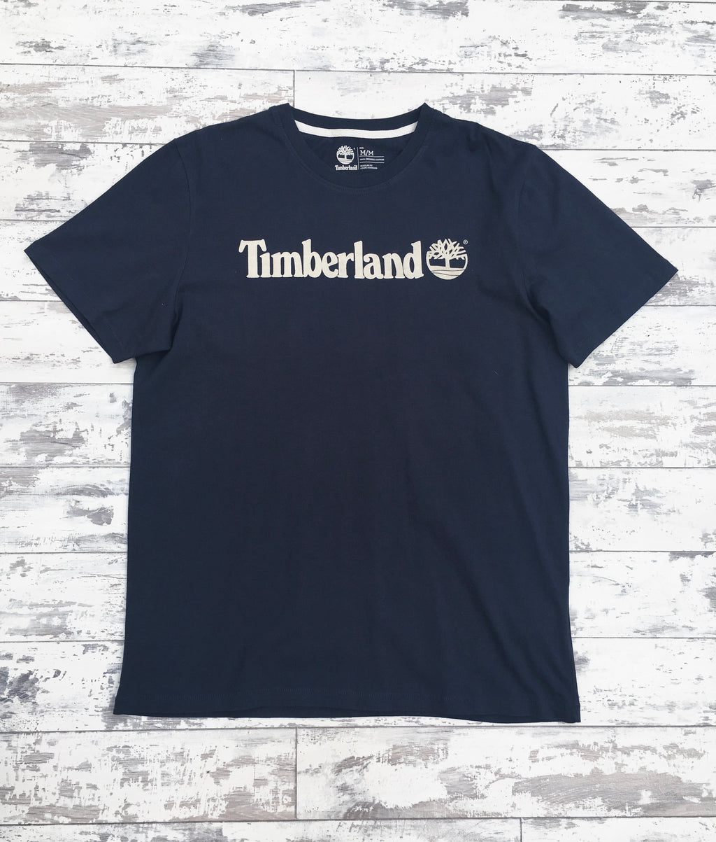 Navy Timberland round-neck tee shirt / Tshirt, with large, cream, printed logo across the chest