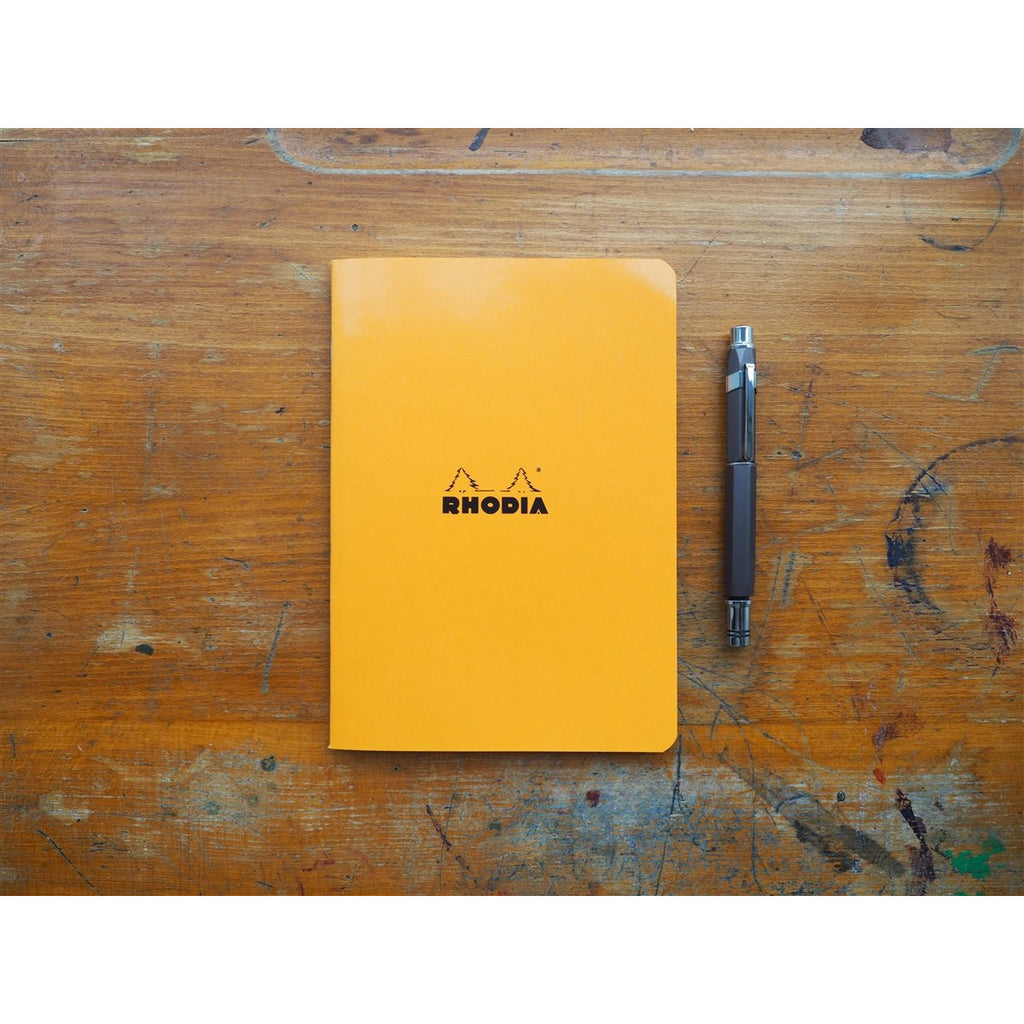 <center>Rhodia Side-Stapled Notebook - Graph - Orange (A5)</center>