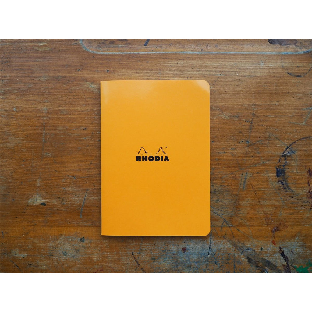 <center>Rhodia Side-Stapled Notebook - Lined - Orange (A5)</center>