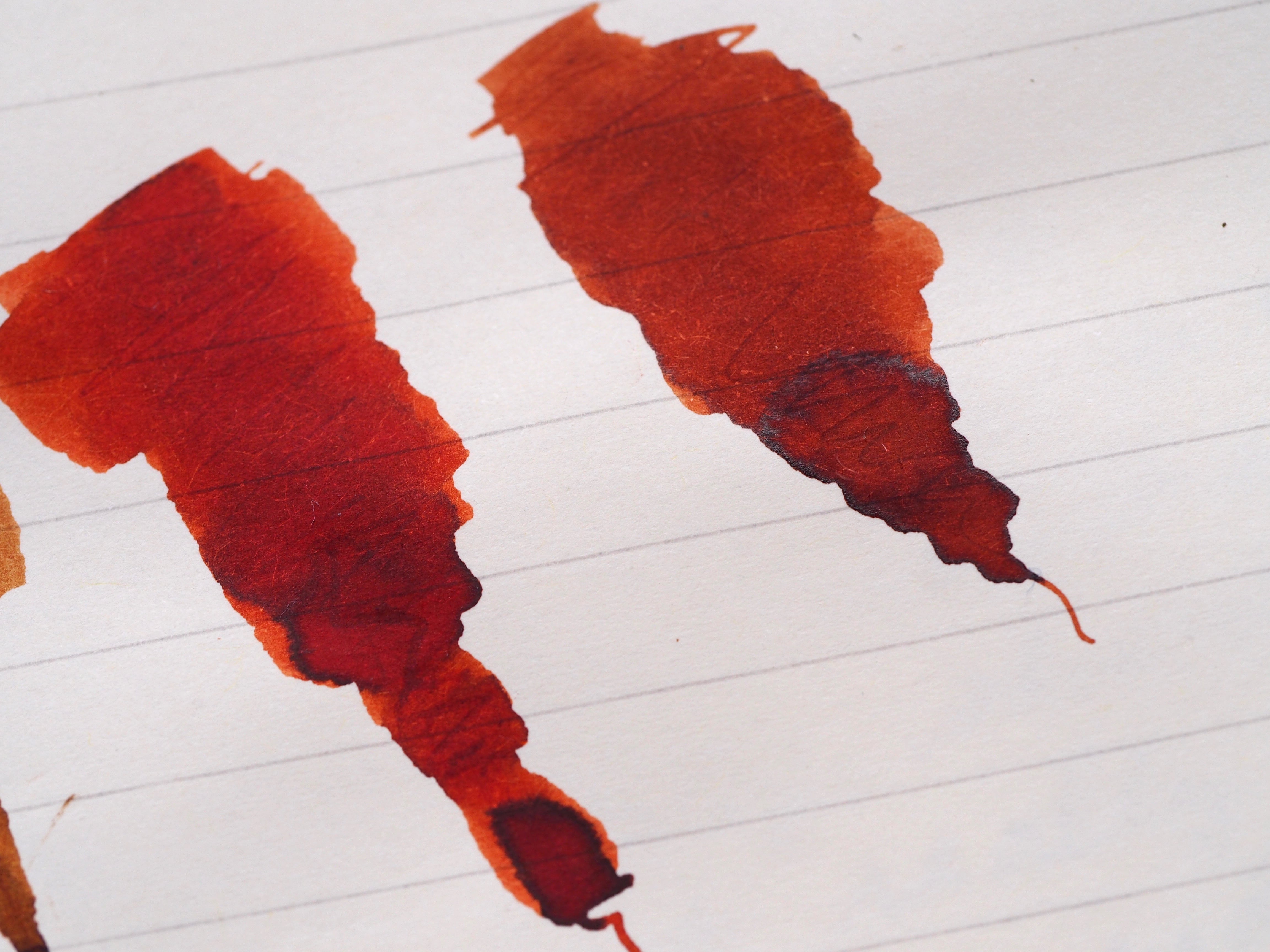 Diamine Ancient Copper on the left, with a bit more red to it, and Diamine 150th Anniversary Terracotta on the right, a bit more brown.