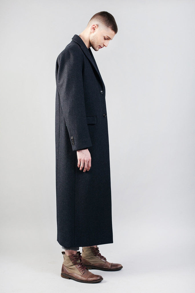 Odd Natives, The 'Bedford' overcoat is made of Italian navy wool imported from Italy, with leather detailing down the back of coat.  Fully lined with matte black buttons. Made in New York City.  Complimentary Shipping.