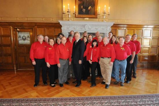 Eureka Springs Citizens in Red Custom Uniforms with Gov. Mike Beebe